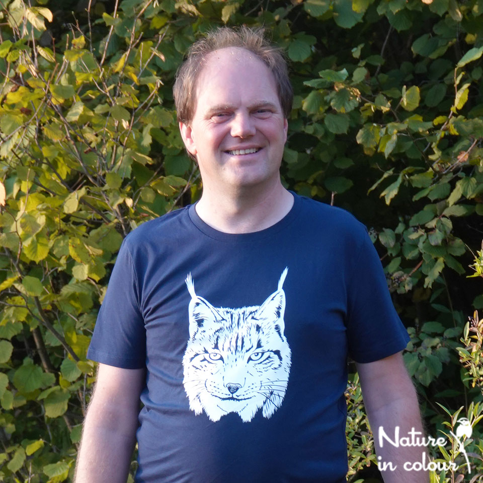Our brand-new bear-friendly T-shirt, shown by the artist and tour guide at Nature in Colour, Paul