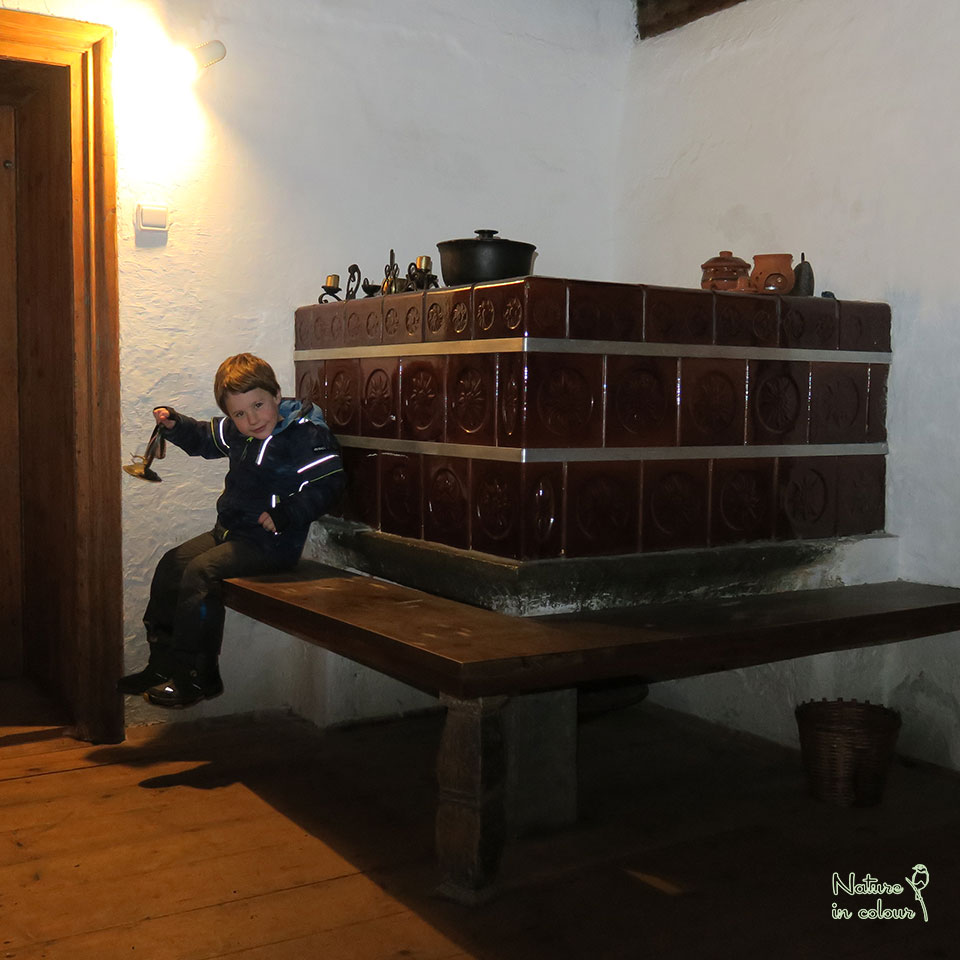 At the wood stove in the Dormouse house in Slovenia